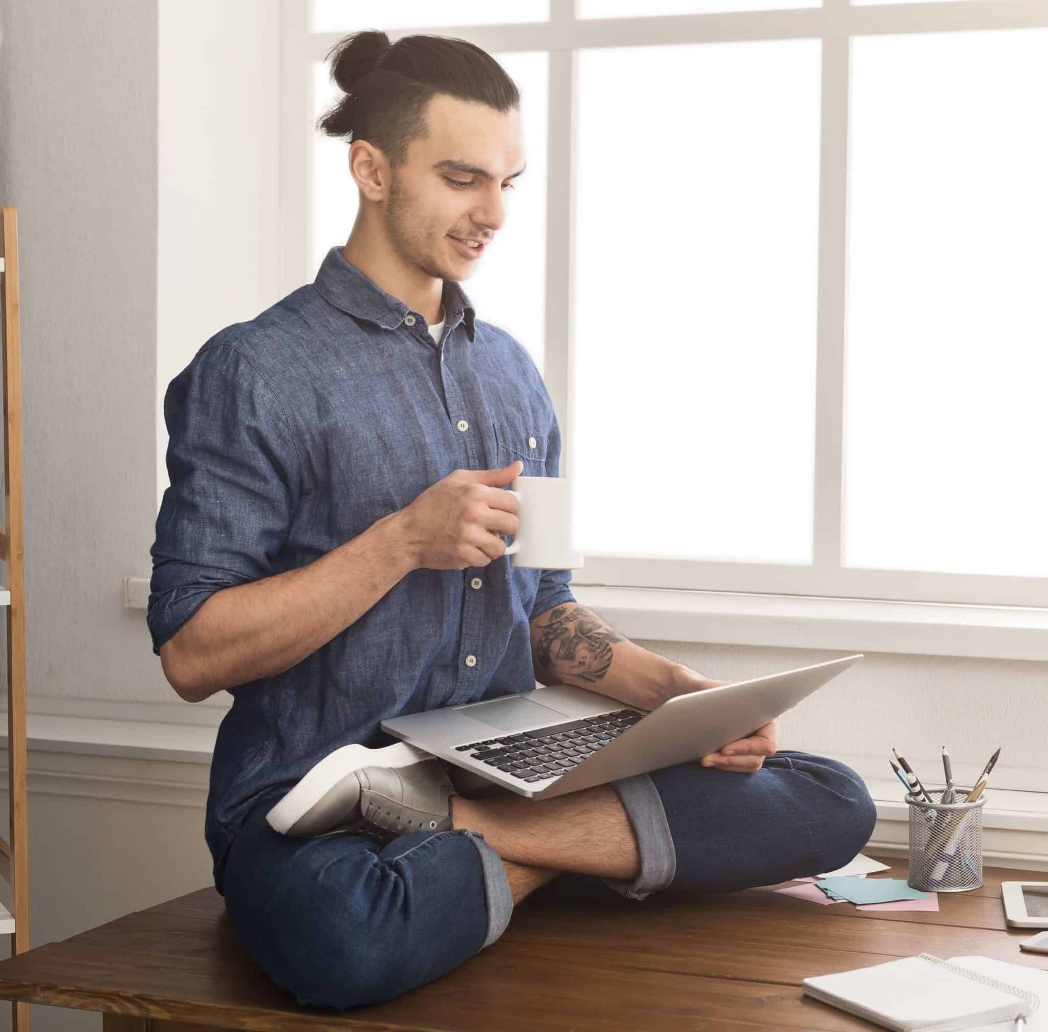 flexible man practicing yoga at workplace