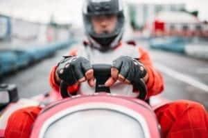 go cart driver in helmet